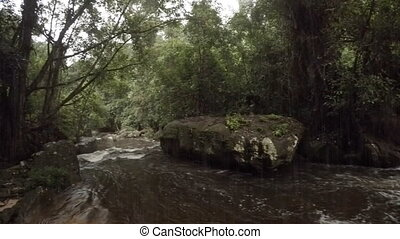 Drizzly Day on the River at Phnom Kulen in Cambodia, with...