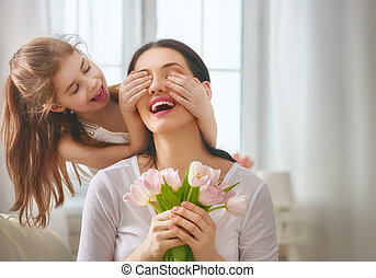 daughter congratulates mom - Happy mother's day! Child...