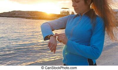 Girl runner with fitness tracker. Sport concept