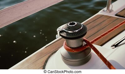 Close-up view of capstan head shining in the sun. Rope...