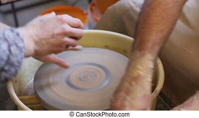 beginning work with claim in pottery - potter begins his...