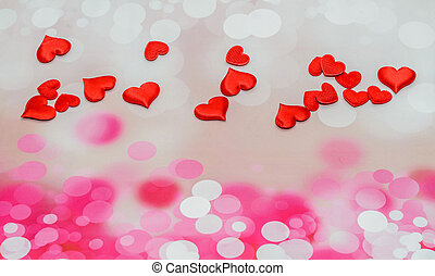 Textile red hearts, Valentines Day hearts, pink bokeh background.