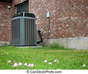 AC - High efficiency modern AC-heater unit on brick wall...