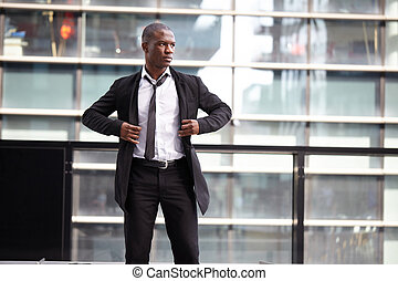 Portrait of a businessman in front of skyscrapers