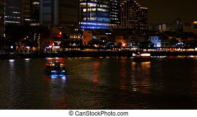 Night time ferry boat traffic with colorful lighting on the...