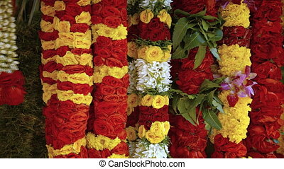 Flower garlands for sale at the singapore market. FullHD...