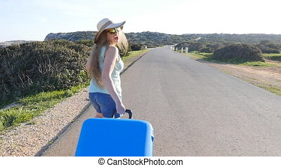 Young woman on vacation with a suitcase. Travel concept