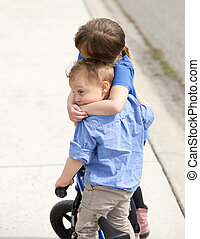 Young boy and girl siblings hugging. - Young boy and girl...