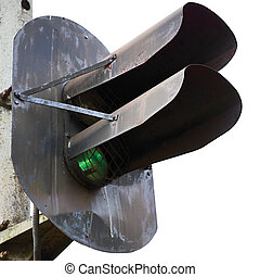 Railroad green light signal isolated closeup - Old rusted...