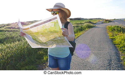Woman traveler looks into the distance. Travel concept