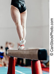 female gymnast balance beam