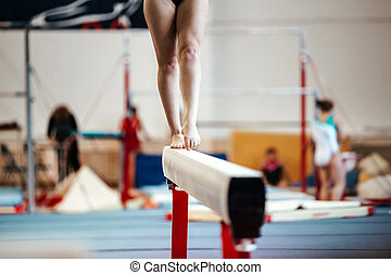 female exercises on balance beam