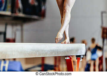 feet woman gymnast on balance beam