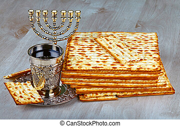 matzo - passover matzo with kiddush cup of wine on wooden...