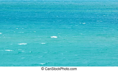 Small Whitecaps on a Blue Sea. FullHD video - Small...