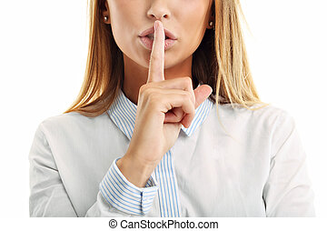 Adult woman holding a finger on her lips over white...