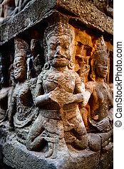 Banteay Srei temple - Bas reliefs in Terrace of the Leper...