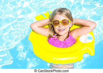 Happy child in swimming pool. Summer vacation - Happy funny...