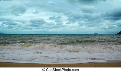 Small Waves Washing a Sandy Beach on a Cloudy Day. - Small,...