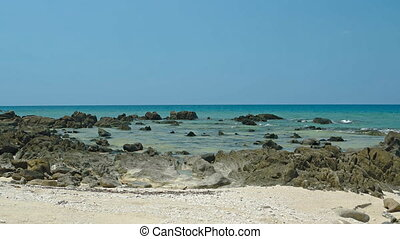 Rocky, Tropical Beach in Phuket, Thailand at Low Tide -...