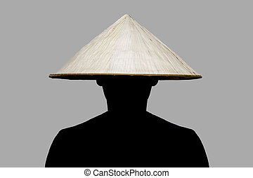 Man with traditional hat from Asia made of wicker