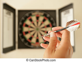 About to throw a dart at dartboard