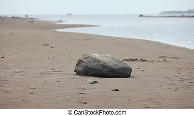 Empty beach Baltic sea boulder foreground at autumn seascape