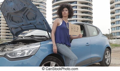 Woman With Broken Car Concept - Woman traveling alone lean...