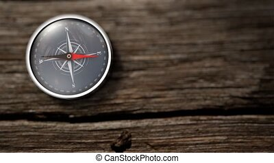 Close up compass showing north on a wooden table. 3D...