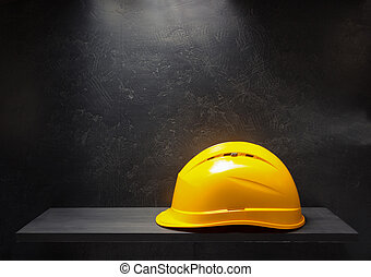 construction helmet on black background