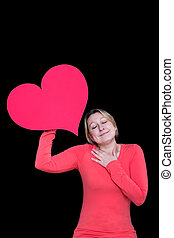Soulful - Woman holds up a red heart and closes her eyes