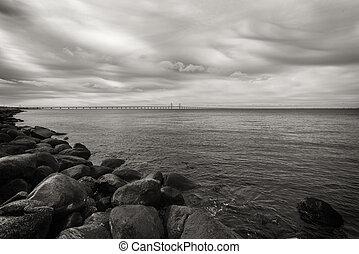 Rocks, sea and Oresund bridge - Large rocks on the sea...