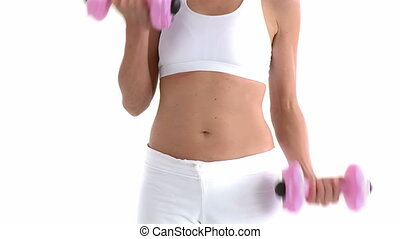 Close up of a woman training with dumbbells against white...