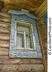 Window of an old house with carved platbands - Old window of...