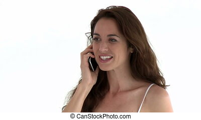 Hispanic woman using cellphone against whit background