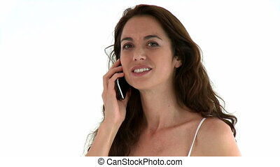 Bright woman on phone standing against a white background