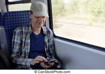 Man with smartphone in a train