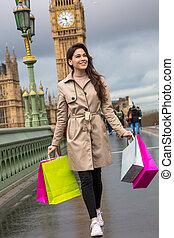 Woman Walking With Shopping Bags, Big Ben, London, England
