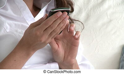 Close-up of woman using cellphone