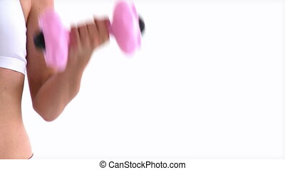Hispanic woman working out with dumbbells against a white...