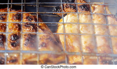 Chicken meat on barbeque grill. Dolly shot