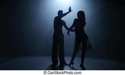 Dance element from the ballroom-sport program, silhouette...