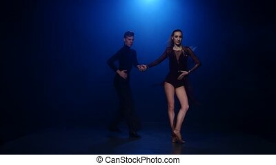 Rumba dancing couple of professional elegant dancers in...