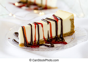 Cheesecake slice with drizzled sauce - Close up of single...