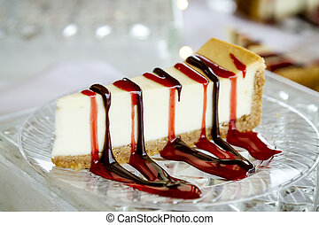Cheesecake slice with drizzled sauce - Dessert display of...