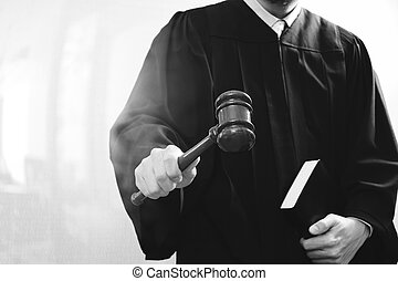 justice and law concept.Male judge in a courtroom with the gavel and holy book