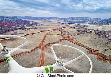 drone flying over mountain valley - aerial photography...