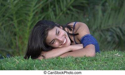 Teen Girl Relaxing In Park