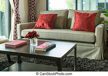 modern living room design with red pillows on sofa
