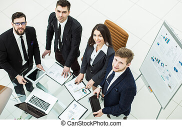 successful business team is preparing for presentation of a new financial project of the company